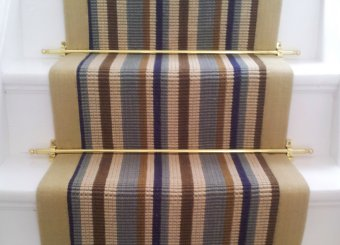 Solid Brass Stair Rods securing a stripped stair runner.